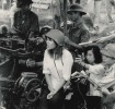 Jane Fonda sitting on an NVA anti-aircraft gun in 1972.